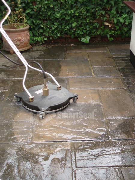 Rotary head power washer on paving slabs